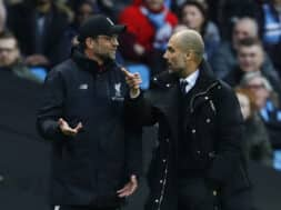 Manchester City manager Pep Guardiola and Liverpool manager Juergen Klopp speak at half time
